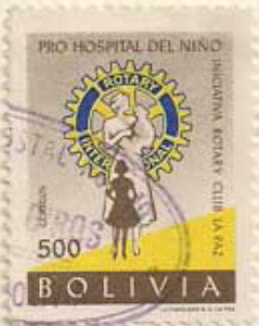 Colnect-852-310-Rotary-Emblem-and-nurse-with-children.jpg