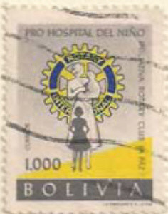 Colnect-852-312-Rotary-Emblem-and-nurse-with-children.jpg