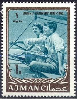 Colnect-2273-431-Kennedy-and-his-wife-aboard-a-sailing-yacht.jpg