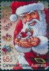 Colnect-2749-733-Santa-holding-a-Red-Crab.jpg