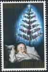 Colnect-2122-652-Sleeping-Child-and-Christmas-Tree.jpg