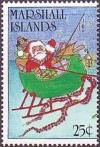 Colnect-3100-571-Santa-Claus-riding-in-sleigh.jpg