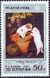 Colnect-2500-166-Puppy-in-basket-touching-noses-with-kitten.jpg