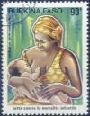 Colnect-819-194-Mother-with-her-child.jpg