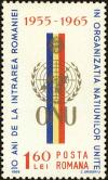 Colnect-4968-121-UNO-badge-in-front-of-Romanian-flag.jpg
