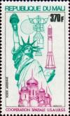 Colnect-2431-279-Apollo-Soyuz-Rocket-Statue-of-Liberty-and-Kreml.jpg