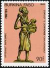 Colnect-4556-429-Mother-and-child---bronze-statue.jpg