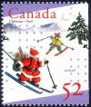 Colnect-2880-000-Santa-and-elf-Skiing.jpg