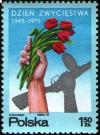 Colnect-1989-677-Hands-holding-tulips-and-rifle.jpg