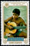 Colnect-3338-043-Boy-playing-guitar.jpg