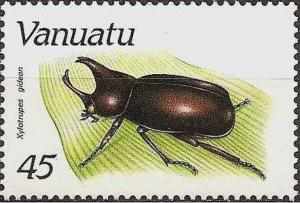 Colnect-1232-179-Brown-Rhinoceros-Beetle-Xylotrupes-gideon.jpg