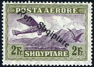 Colnect-2315-033-Airplane-Crossing-Mountains-overprinted.jpg