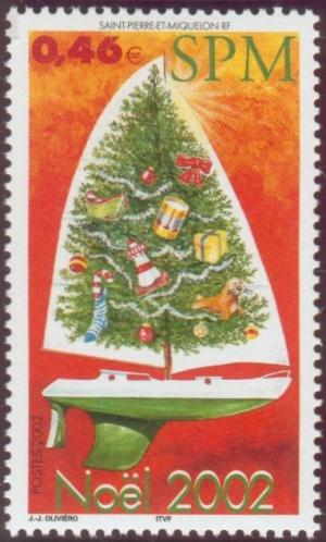 Colnect-878-736-Sailing-boat-with-a-decorated-Christmas-tree.jpg