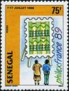 Colnect-2089-754-Couple-Viewing-Stamp-on-Easel.jpg