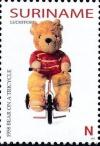 Colnect-3979-160-1958-Bear-on-a-Tricycle.jpg
