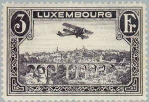Colnect-133-510-Biplane-over-Luxembourg-City.jpg